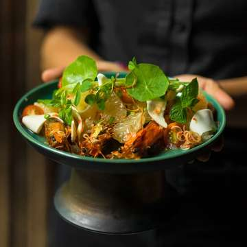 """Something light to start the night. Grilled prawn and pomelo salad with palm heart lemongrass shallots kencur Asian celery and red """"nahm jihm"""""""