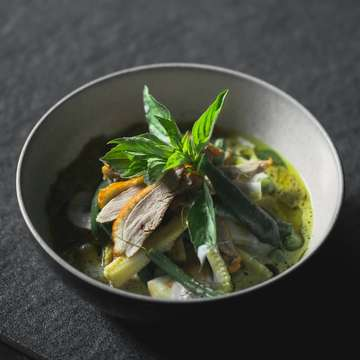 """A must try for all Thai green curry lovers. """"Gaeng kiew wan"""" green curry of roasted peking duck with apple eggplant baby corn long bean and Thai basil."""